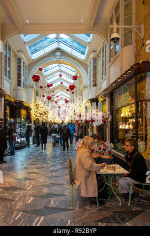 Shoppers walkling through the historic (1819) Burlington Arcade in Mayfair, central London, England, UK. - Stock Image