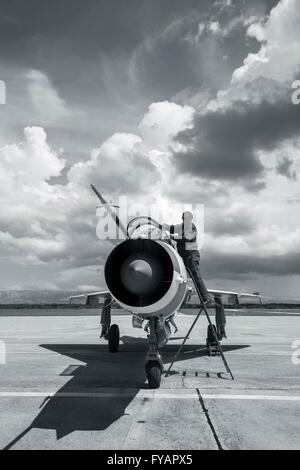 Mechanic cockpit clouds from nose - Stock Image