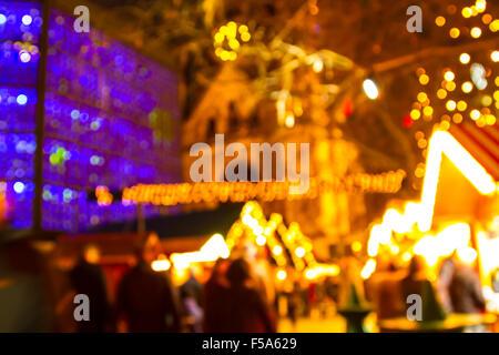Defocus Christmas market of Berlin at night - Stock Image