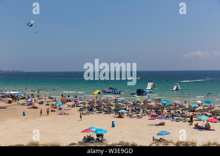 Mil Palmeras Costa Blanca Spain with beautiful weather parasailing and beach water slides - Stock Image