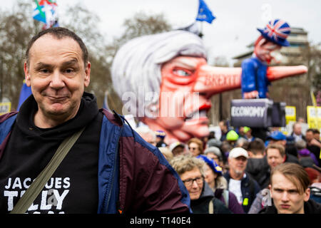 London, UK. 23rd Mar, 2019. Portrait of designer Jacques Tilly in front of his Brexit float with a Theresa May effigy. Remain supporters and protesters take part in a march to stop Brexit in Central London calling for a People's Vote. Credit: Vibrant Pictures/Alamy Live News - Stock Image