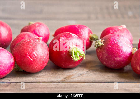 Ripe radishes on a wooden surface - Stock Image