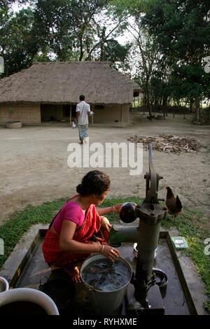 BANGLADESH Household chores for a Garo tribal minority family of Haluaghat, Mymensingh region photo by Sean Sprague - Stock Image