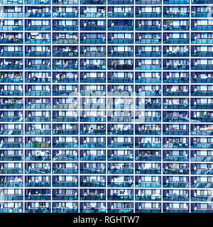 Blue pattern with small balconies and windows, Osaka, Japan - Stock Image