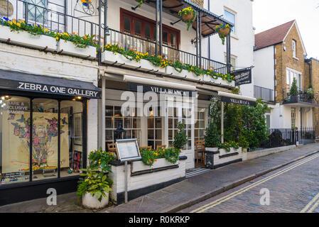 Zebra One Gallery and Villa Blanca restaurant in Perrin's Court, Hampstead, London, England, UK. - Stock Image