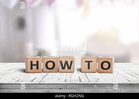 How to sign in a room on a wooden table in bright daylight - Stock Image