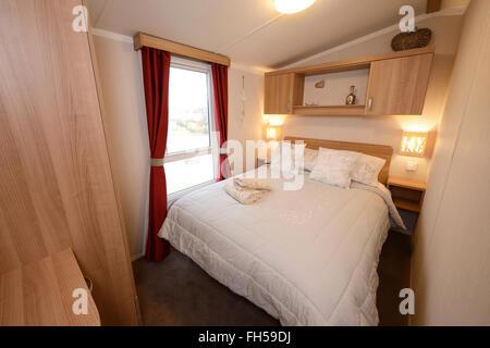Double bedroom interior of a static caravan - Stock Image