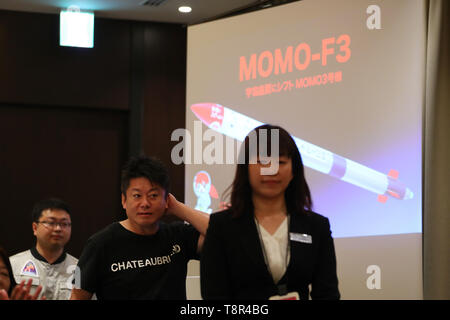 Takafumi Horie, 2nd left, founder of Interstellar Technologies Inc. attends during a press conference at the Foreign Correspondents' Club of Japan in Tokyo on May 15, 2019. A Japanese aerospace startup successfully launched a small unmanned rocket MOMO-3 earlier this month, making it the country's first privately developed model to reach the outer space. Credit: Yohei Osada/AFLO/Alamy Live News - Stock Image