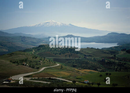 Distant view of snow-capped peak of Mount Etna in Sicily, Italy - Stock Image