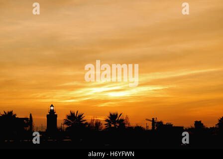 Landscape of lighthouse with orange sky at sunset in Rimini,Italy - Stock Image
