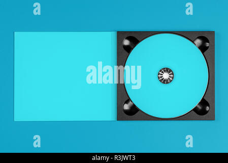 Pastel blue cd in case on pastel blue background - Stock Image