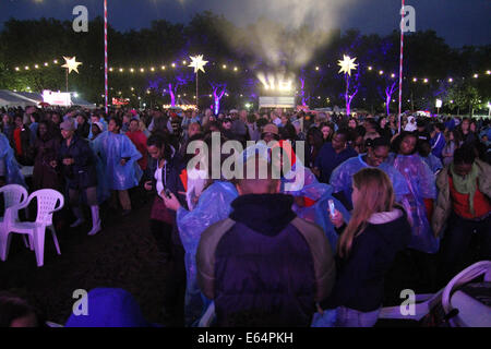 Hundreds of Newham residents who braved  the wet weather to dance to disco tunes at Central Park. Credit: David - Stock Image