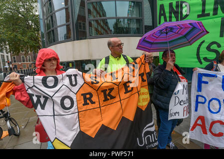 London, UK. 17th October 2018. Unite  Housing workers at the protest outside the Ministry of Housing, Communities and Local Government by residents living in tower blocks covered in Grenfell-style cladding, Fuel Poverty Action, and Grenfell campaigners demanding that the government make all tower-block homes safe and warm. Credit: Peter Marshall/Alamy Live News - Stock Image