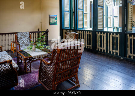 Resting area and shutters on first floor, Tjong A Fie Mansion, Medan, North Sumatra, Sumatra, Indonesia. - Stock Image