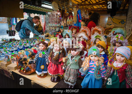 Dolls shop, view of tourists browsing a doll stall in the Havelske - the largest street market in Prague, Czech Republic. - Stock Image