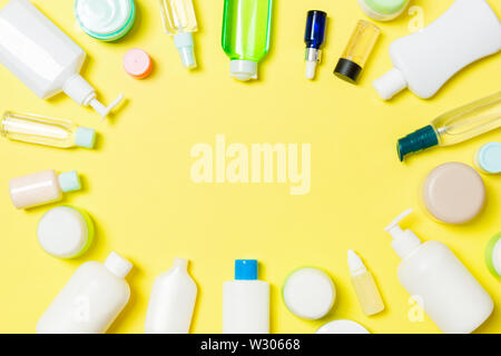 Frame of plastic bodycare bottle Flat lay composition with cosmetic products on yellow background empty space for you design. Set of White Cosmetic co - Stock Image