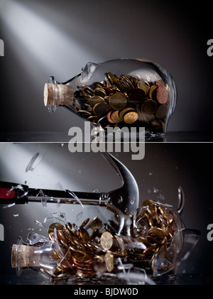Piggy bank gets smashed - Stock Image
