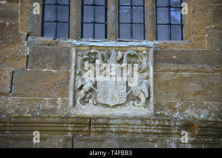 Coats of arms on the gatehouse belonging to Wormleighton Manor in the Warwickshire village of the same name. Spencer coat of arms - Stock Image