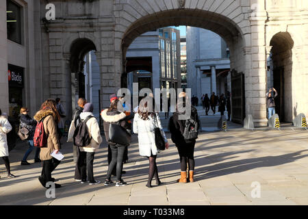 Rear view of young women in a tour group of visitors tourists in the City of London England UK  KATHY DEWITT - Stock Image