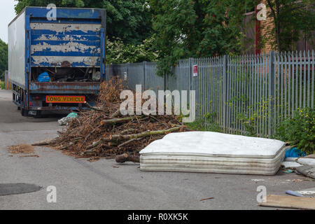 Fly tipping including complete articulated vehicle trailer, Heathrow / Colnbrook, England - Stock Image