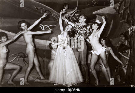 Performers of the Folies Bergere, Paris, France - featuring semi-nude dancers. - Stock Image