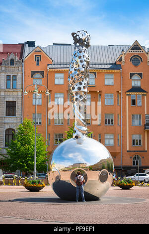 Finland architecture Helsinki, view of Art Nouveau styled buildings and the huge steel Lightbringer monument sited in Kasarmitori square in Helsinki. - Stock Image
