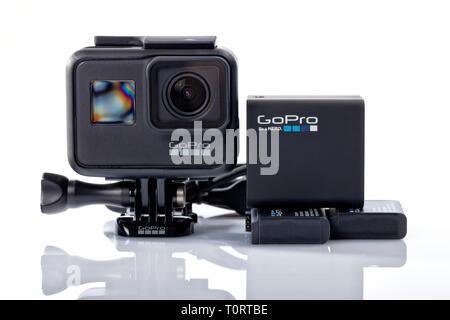 GoPro Hero 7 Black with charger and batteries isolated on white. - Stock Image