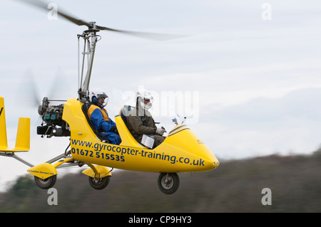 Rotosport Gyrocopter lifts off for an air experience flight at Popham airfield near Basingstoke, Hampshire, England - Stock Image