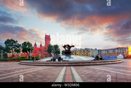 Red Church or Church Of Saints Simon and Helen, Fountain at independence Square in Minsk, Belarus - Stock Image