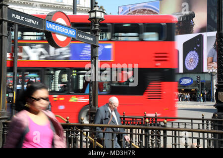 London, UK. 18th April 2018. The entrance to Piccadilly Circus Underground station in central London, with a London bus driving past, on 18 April 2018 Credit: Dominic Dudley/Alamy Live News - Stock Image