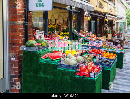 Colourful display of fruit and vegetables outside Boz, a traditional old-fashioned greengrocer in Woking town centre, Surrey, south-east England - Stock Image