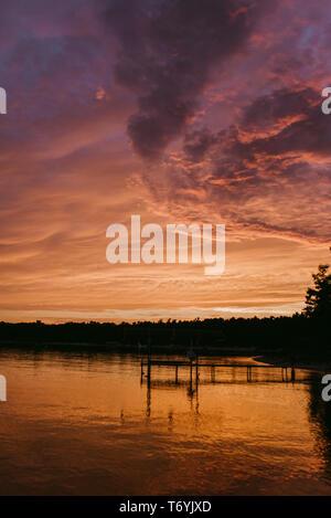 Dramatic sky at sunset with reflection on Lake Michigan - Stock Image