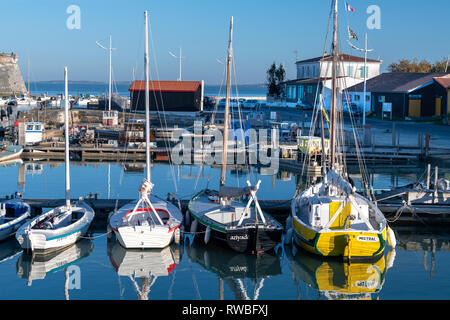France, 2018, France, 2018, Reflection of moored fishing boats on the harbour's water. - Stock Image