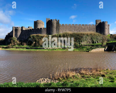 Pembroke Castle - medieval castle in Pembroke, Pembrokeshire, Wales. The castle was the original family seat of the Earldom of Pembroke. A Grade I lis - Stock Image