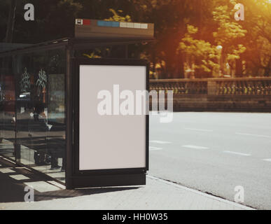 City bus stop with empty mock up banner for your advertising, blank billboard with copy space area for your text - Stock Image