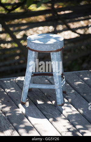 Close-up of a stool on deck - Stock Image