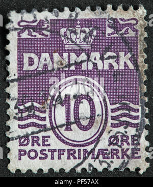 used 10 ore Danmark Denmark, purple postage stamp - Postfrimaerke - Stock Image
