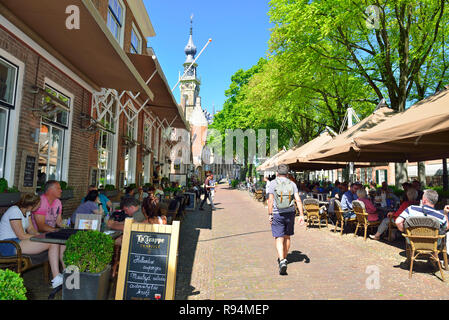 Tourists in the historical picture postcard village of Veere a holiday town on the Veerse Meer Lake in the province of Zeeland, Holland, Netherlands - Stock Image
