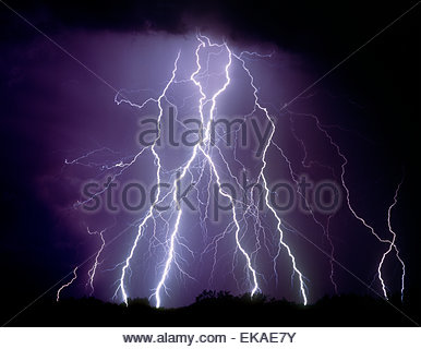Lightning strikes in the desert north of Tucson Arizona in a summer monsoon type thunderstorm. - Stock Image