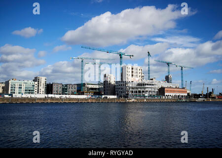 cranes and new office developments at north dock in the docklands waterfront river liffey Dublin Republic of Ireland europe - Stock Image