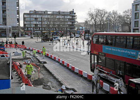 Roadworks men working at Elephant and Castle in London UK KATHY DEWITT - Stock Image