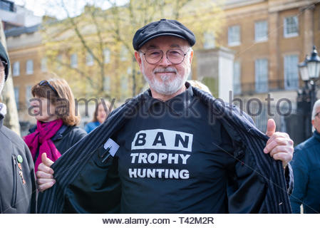 London, UK. 13th April 2019. A protest march is taking place in London demonstrating against the threat of extinction of wildlife and highlighting the act of trophy hunting in particular of elephants and rhinos. It is part of the 5th global march for elephants and rhinos and is timed to take place before a conference in Sri Lanka calling to uplist elephants to Appendix I (highest level of protection) and to reject proposals to allow the ivory trade of the Southern White Rhino. Protesters gathered in Cavendish Square and marched to Whitehall. Peter Egan. Credit: Avpics / Alamy Live News - Stock Image