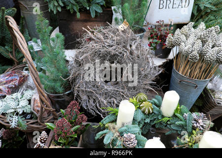A garden stall with wreath constructed of roots for sale, Christmas foliage and plants at Borough Market in London England UK  KATHY DEWITT - Stock Image