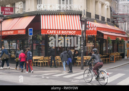 Paris street scene on Boulevard Magenta, in front of the cafe Le Bistrot, in the 10th arrondissement. France. - Stock Image