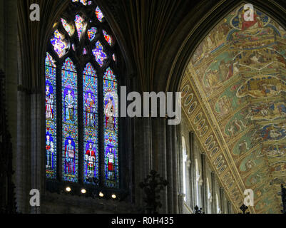 Stained glass window and magnificent painted ceiling in Ely Cathedral, Cambridgeshire. - Stock Image