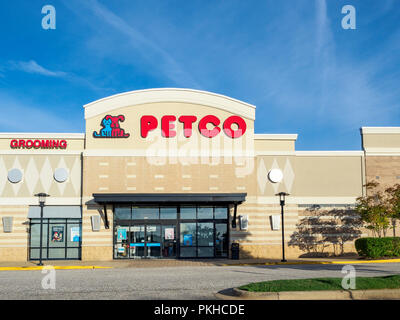 Front exterior entrance of Petco retail pet store showing the corporate sign and logo in Montgomery Alabama, USA. - Stock Image