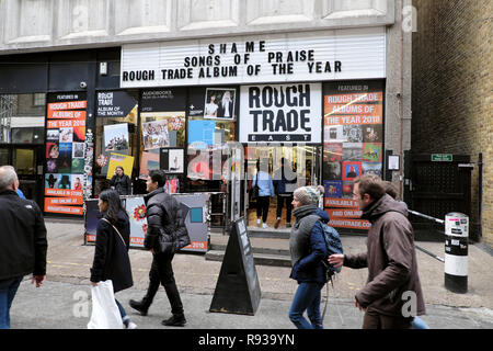 Rough Trade East music store exterior and people pedestrians walking in the street outside the store near Brick Lane in East London UK  KATHY DEWITT - Stock Image