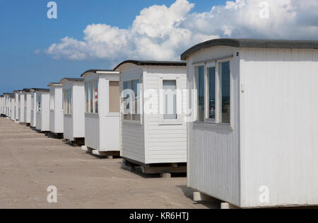 White beach cabins on the beach at Blokhus, a popular tourist resort at the North Sea in the north-western part - Stock Image