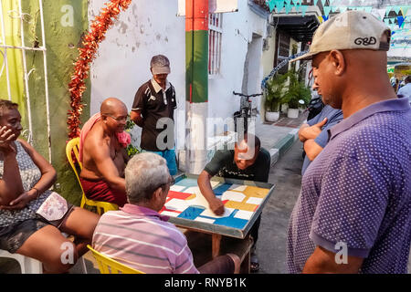 Cartagena Colombia Old Walled City Center centre Getsemani Black Hispanic man woman residents neighborhood outdoor board game Parques Colombian game v - Stock Image