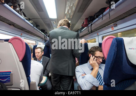 First Great Western train interior with male commuters - Stock Image